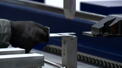 Worker fix a metal detail and the robotized machine squeezes out iron Stock Footage