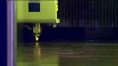The industrial laser cuts the sheet of iron. Sparks fly from laser Stock Footage