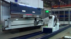 Тhe robotized machine processes the sheet of iron Stock Footage