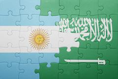 Puzzle with the national flag of saudi arabia and argentina Stock Photos