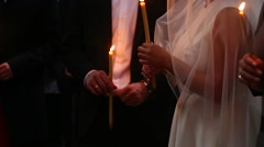 The candles in Georgian Church. Long lighted candles group on black backgroun Stock Footage