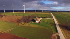 Rural landscape dotted with wind turbines, dramatic sky, Aerial View Stock Footage
