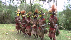 Papuan Man With Drums During Ritual With Face Paint in Papua New Guinea - stock footage