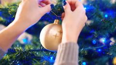 Decoration of the Christmas tree with balls - stock footage