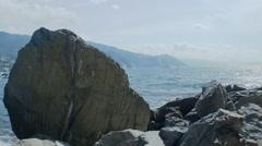 Passenger Boat at Sea near Bright Sunny Ligurian Coast - 25FPS PAL Stock Footage