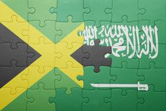 Puzzle with the national flag of saudi arabia and jamaica Kuvituskuvat