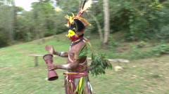 Papuan Men Call For Ritual With Face Paint in Papua New Guinea - stock footage