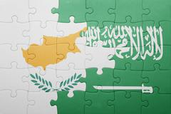 Puzzle with the national flag of saudi arabia and cyprus Stock Photos