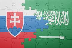 puzzle with the national flag of saudi arabia and slovakia - stock photo
