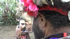 Papuan men in Papua New Guinea prepare for ritual Stock Footage