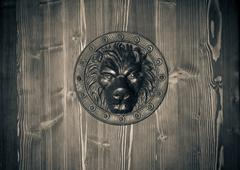 Brass lion head on the door black and white Stock Photos