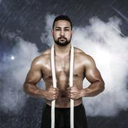 Stock Photo of Composite image of muscular man with battle rope
