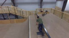 Stock Video Footage of 4k aerial bmx going back and forth on ramp