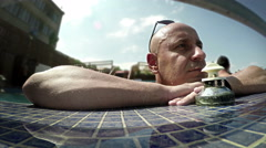 Healthy lifestyle. Middle-aged man relaxing in a swimming pool Stock Footage