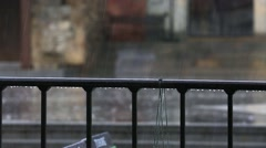 Heavy rain in the street early afternoon. rain pouring down. Heavy downpour of r Stock Footage