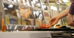 people in the canteen  choose what to eat - stock footage