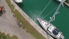 Aerial Drone hover tilt down mast sailboat Marina Hemingway - stock footage