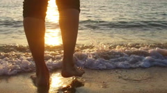 SLOW MOTION: man running in shallow sea at sunset 1920x1080 - stock footage