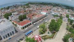 Aerial Cuba, roatation 360 Parque Central, neighborhood roof water horizon Stock Footage
