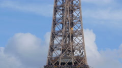 Tour Eiffel tourists and elevator pan Stock Footage