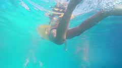 Underwater clip of boy swimming in Swimming pool with mother SLOW MOTION Stock Footage