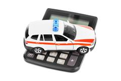 Calculator and toy police car Kuvituskuvat