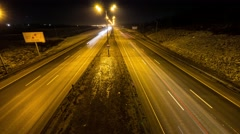 Intensive traffic at night, two way roadm timelapse Stock Footage