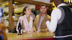 4K Attractive couple enjoying a taster session in specialist wine shop - stock footage