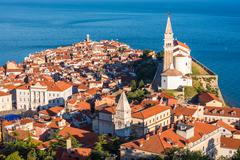 Sunlit Old Town of Piran in the Morning. Stock Photos