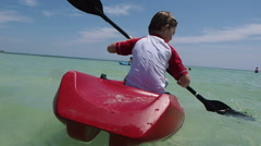 Boys Playing In Ocean On Kayak Stock Footage
