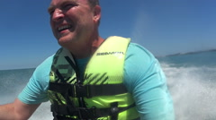 Man Riding Jet Ski In Ocean Stock Footage