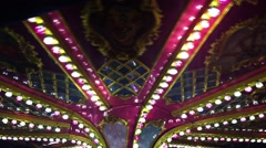 Stock Video Footage of Carousel in Amusement Park in Fun Fair Merry Go Round