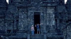 Happy family having fun during sightseeing Prambanan temple Stock Footage