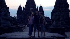 Family taking photo with cellphone in Prambanan temple in Indonesia Stock Footage