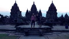 Happy father with teenage son sightseeing Prambanan temple in Indonesia Stock Footage