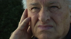 Daydreaming old man: pensive elderly man Stock Footage