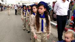 Boys and girls scouts parade during a procession parade to St. George church Stock Footage