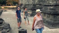 Happy family sightseeing Prambanan temple in Indonesia Stock Footage