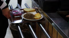 A tray of food at the cash register in a fast food restaurant Arkistovideo