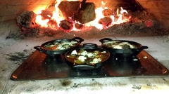 Frying escargot snail pans, in a wooden warmed oven, at a restaurant Stock Footage