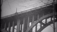 1936: New bridge design documented from riverbed to support structure. SAXTON, Stock Footage