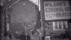 1936: Wilson's Garage general repair work on all cars flooded from storm. Stock Footage