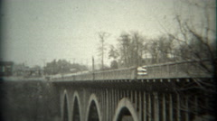 1936: New bridge style inspection from top deck down to foundations. SAXTON, Stock Footage