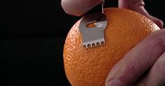 Citrus zester on dark background Stock Footage