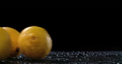 Raw citrus fruit rolling in dark background Stock Footage
