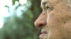 elderly 70s man: side portrait of thoughtful man; wrinkled old man  - stock footage