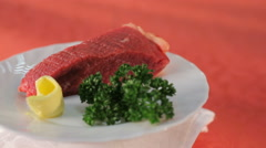 Fillet of fresh meat and green on white plate Stock Footage