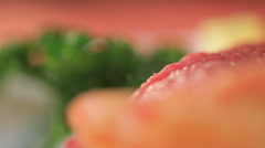 Fillet of raw meat, green and butter on white plate - stock footage