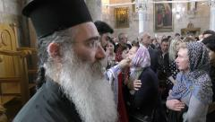 Stock Video Footage of LOD, ISRAEL: A priest administers communion during the Celebration