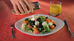 Olive oil pouring over mixed salad on the white plate - stock footage